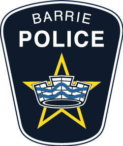 Barrie Police Service crest with the words Barrie Police, an image of a masonry crown representing civic authority. On the crown are two wavy blue lines alluding to Barrie's location on the lake, these are set over five interlacing gold lines representing the five major provincial highways that intersect Barrie.