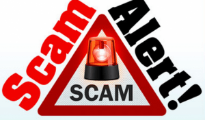 Graphic with the words SCAM ALERT around a red triangle and a emergency red light.